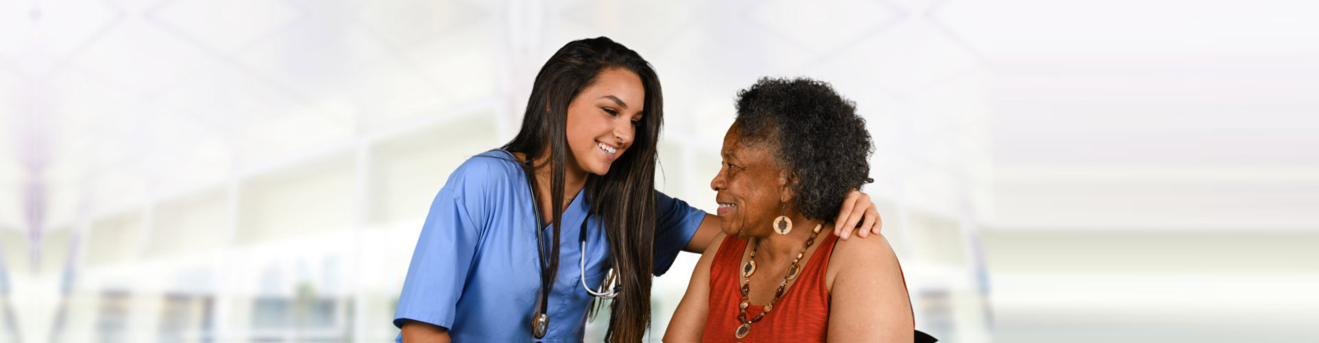 caregiver with elder woman looking at each other